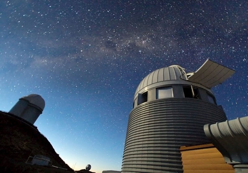 In the search for distant worlds, few telescopes have had as much success as ESO's 3.6-metre telescope and the Swiss 1.2-metre Leonhard Euler Telescope, both of which are shown in this image. The 3.6-metre telescope is home to HARPS (High Accuracy Radial velocity Planet Searcher), a spectrograph with unrivalled precision, and holder of many records in the field of exoplanet research, including the discovery of the least massive exoplanet, as well as of the smallest ever measured. Together with HARPS, the Leonhard Euler Telescope has allowed astronomers to find that six exoplanets from a larger sample of 27 were orbiting in the opposite direction to the rotation of their host star — providing an unexpected and serious challenge to current theories of planet formation. At 2400 metres above sea level in the southern part of Chile's Atacama Desert, La Silla was ESO's first observation site. Along with the 3.6-metre telescope, it also hosts the New Technology Telescope (NTT) and the MPG/ESO 2.2-metre telescope as well as several national and smaller telescopes.